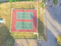Aerial tennis court at public park in Ozark, Arkansas, USA. Aerial view public tennis court in rural Ozark, Arkansas, America at sunset. Top view outdoor court royalty free stock image