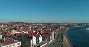 AERIAL. Tilt opening shot through Vytautas church to Kaunas old town panorama on beautiful sunny spring day in Lithuania. 4k. AERIAL. Tilt opening shot through stock video