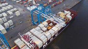 Aerial Time Lapse of Loading & Unloading of Cargo Ship stock video footage
