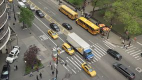 Aerial time lapse view of traffic at an intersection. A view of a typical New York City intersection stock footage