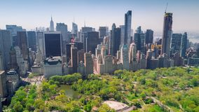 Aerial view of Central Park, Upper East and West Side Manhattan and Midtown Manhattan, New York, USA. Aerial timelapse dronelapse view of Central Park, Upper stock footage