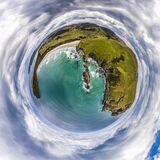 Aerial tiny planet of the green cliffs and blue ocean