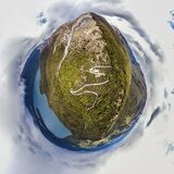 Aerial tiny planet of path heading on top of mountain