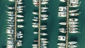 Aerial top down view of a Greek marina and sailboats. Aerial top down shot of a Greek marina and sailboats stock video