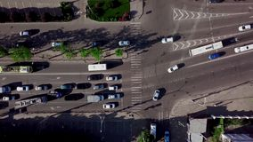 Drone`s Eye View - Directly above view of rush hour traffic. Aerial top down shot of a traffic jam on a car road intersection in the rush hour stock video footage