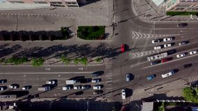 Drone`s Eye View - Rush hour traffic on city road. Aerial top down shot of a traffic jam on a car road intersection in the rush hour stock video