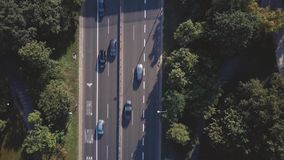 Aerial top down view of a car road within park Royalty Free Stock Images
