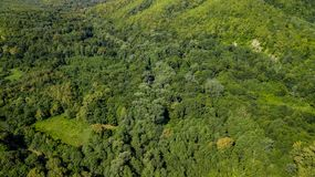 Beautiful aerial landscape views of the Caucasus Mountains and Forest. Aerial Top Down View Of Caucasus Mountains Forest Trees On A Sunny Summer Day royalty free stock photo