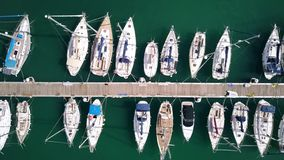 Aerial top-down view of docked sailboats at marina. Aerial top-down view of docked sailboats stock images