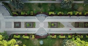 Summer aerial drone footage of city park with gardening. Aerial top down view from drone stock video