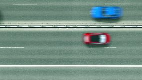 Aerial top down view of the road with cars revealing Stockholm caption. Car travel in Sweden conceptual clip stock footage
