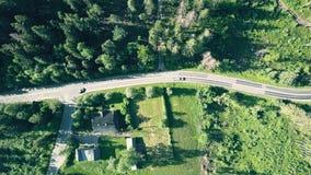 House and a car road in Zakopane Poland. Aerial top down view of a house and a car road in Zakopane, Poland stock video