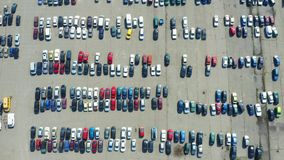 Aerial top down view of many cars on a parking lot or sale car dealer market. Aerial