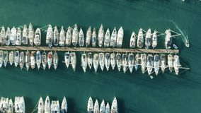 Aerial top down view of many docked sailing yachts in marina. Aerial top down view of many docked sailing yachts stock video