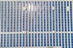 Aerial top down view on many Solar panels rows lined up on of factory roof stock photos