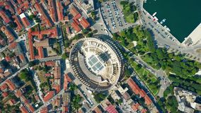 Aerial top down view of Pula city and famous ancient Roman amphitheatre in Croatia Royalty Free Stock Images