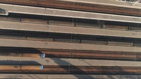 Aerial top down view of railway hub with passenger trains next to each other. Aerial top-down view of railway station hub with passenger trains next to each stock video footage