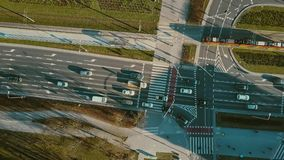 Aerial top down view of road traffic on major city street. Aerial top down view of road traffic on city street stock footage
