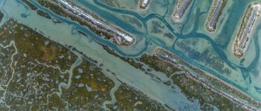 Aerial top down view seascape in Ria Formosa wetlands natural park, Algarve. Aerial top down view seascape in Ria Formosa wetlands natural park, inland maritime Royalty Free Stock Photo