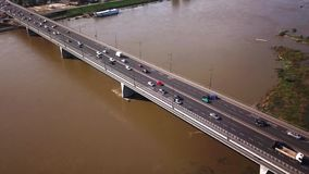 Aerial top down view shot of traffic jam on a car bridge in the evening rush hour. Bridge stock video footage
