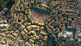 Aerial top-down view of Siena involving Piazza del Campo or Campo Square, a place of famous horse-race, Palio di Siena. Italy royalty free stock image