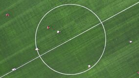 Aerial Top Down View of Soccer Field. Beginning of game. Two teams playing ball in football outdoors. Head over shot.