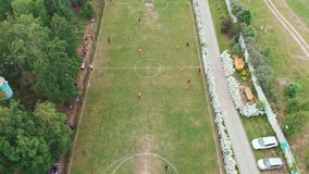 Aerial top down view of soccer field. Non-professional amateur football match. Drone shooting. Aerial top down view of soccer field and two amateur team playing stock video