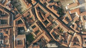Aerial top down view of streets and tiled houses in Alessandria. Piedmont, Italy. Aerial top down view of streets and houses in Alessandria stock footage