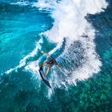 Aerial top down view of the surfer stock photo