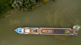 Aerial top down view of tourism motorboat on river garonne, Bordeaux Vineyard royalty free stock image