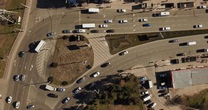 Aerial top down shot of a traffic jam on a car road intersection in the rush hour. 4K video. Aerial top down view of traffic jam stock video
