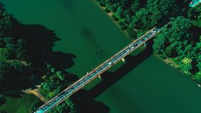 Aerial top down view of traffic jam on a car bridge. 4K video. Aerial top down view of traffic jam on a car bridge and moving train. 4K video stock video