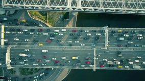 Aerial top down view of traffic jam on a car bridge and moving train Royalty Free Stock Photos