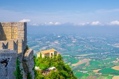 Aerial top panoramic view of Basilica Pieve, Palazzo Pubblico palace and landscape with valley, green hills, San Marino royalty free stock photo