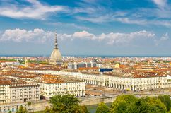 Aerial top panoramic view of Turin city center skyline with. Piazza Vittorio Veneto square, Po river and Mole Antonelliana building with high spire, blue sky royalty free stock photography