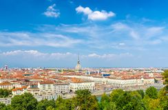 Aerial top panoramic view of Turin city center skyline. With Piazza Vittorio Veneto square, Po river and Mole Antonelliana building with high spire, blue sky stock photos
