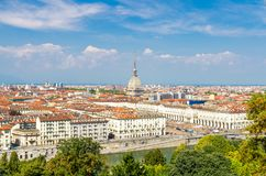 Aerial top panoramic view of Turin city center skyline. With Piazza Vittorio Veneto square, Po river and Mole Antonelliana building with high spire, blue sky stock image