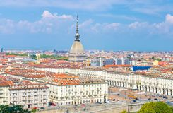 Aerial top panoramic view of Turin city center skyline with Piazza Vittorio Veneto square. Po river and Mole Antonelliana building with high spire, blue sky stock photography