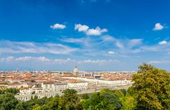 Aerial top panoramic view of Turin city center skyline. With Piazza Vittorio Veneto square, Po river and Mole Antonelliana building with high spire, blue sky stock photography