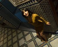 Aerial shot Beautiful Moroccan Girl in Short Golden Dress in Rich Mosaic interior of Picturesque Dar Si Said Riyad in. Aerial top shot Beautiful Moroccan Girl in royalty free stock photography