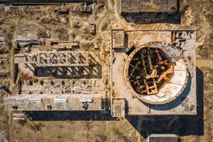 Aerial top view of abandoned and ruined Nuclear Power Plant in Shelkino, Crimea. Large USSR industrial construction royalty free stock images