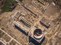 Aerial top view of abandoned and ruined Nuclear Power Plant in Shelkino, Crimea. Large USSR industrial construction stock photos