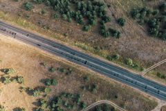 Aerial top view of asphalt road in rural area or countryside Stock Photo