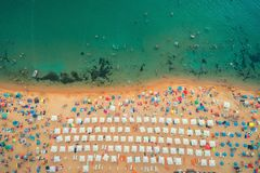 Aerial top view on the beach. People, umbrellas, sand and sea wa. Ves stock photography