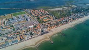 Aerial top view of beach resort town on Mediterranean sea from above, vacation and holiday destination in France. Aerial top view of beach resort town on royalty free stock image