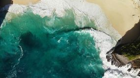 Aerial top view beach with waves and rock. Indonesia. Bali royalty free stock image