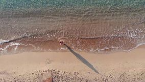 Aerial top view on the beach. Summer time morning. stock footage