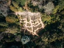 Aerial top view of beautiful green park with different trees and pathways in Nikitsky botanical garden, Crimea. Landscape design stock image
