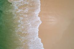 Aerial top view beautiful sea landscape, beach and wave with turquoise sea water with copy space.  stock photos