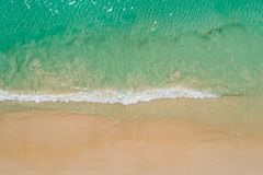 Aerial top view beautiful sea landscape, beach and wave with turquoise sea water with copy space.  stock photography